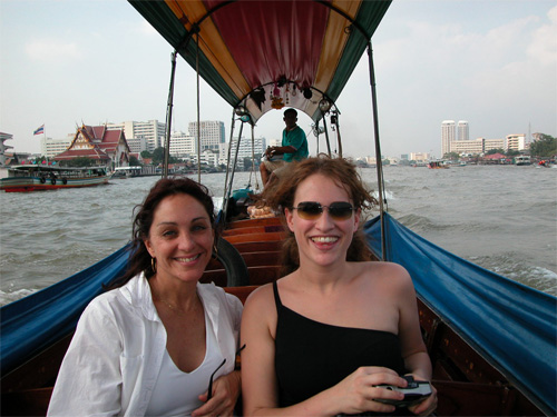 Robin with her daughter on boat in Bangkok