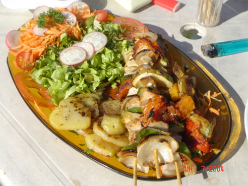 Brazil, Buzios :: typical meal of fish brochette served at a beach snack. I won't starve here.
